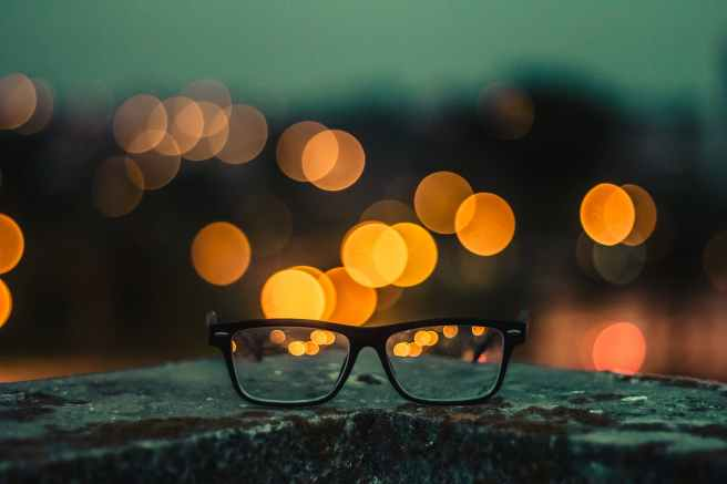 bokeh photography of black framed eyeglasses